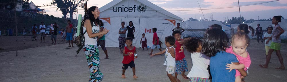 mel irvine dancing with tent city kids estanctia iloilo