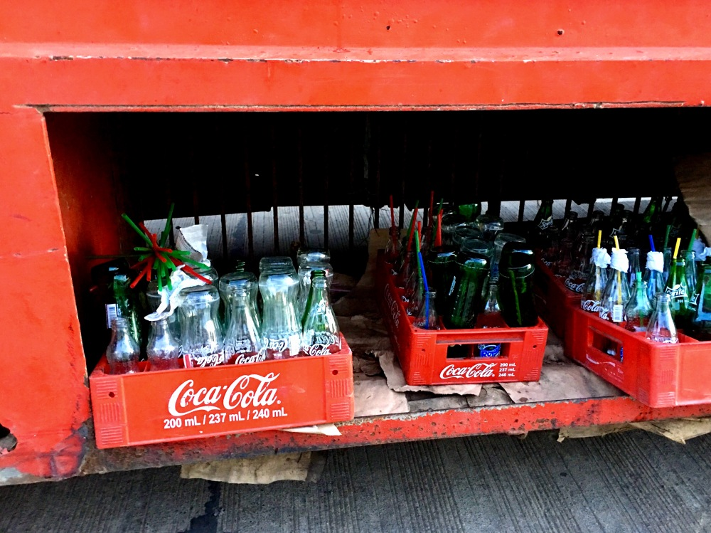 empty coke and sprite bottles ready for recycling