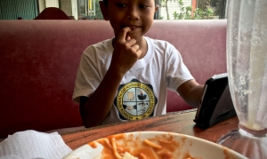 little kid and a bowl of spaghetti
