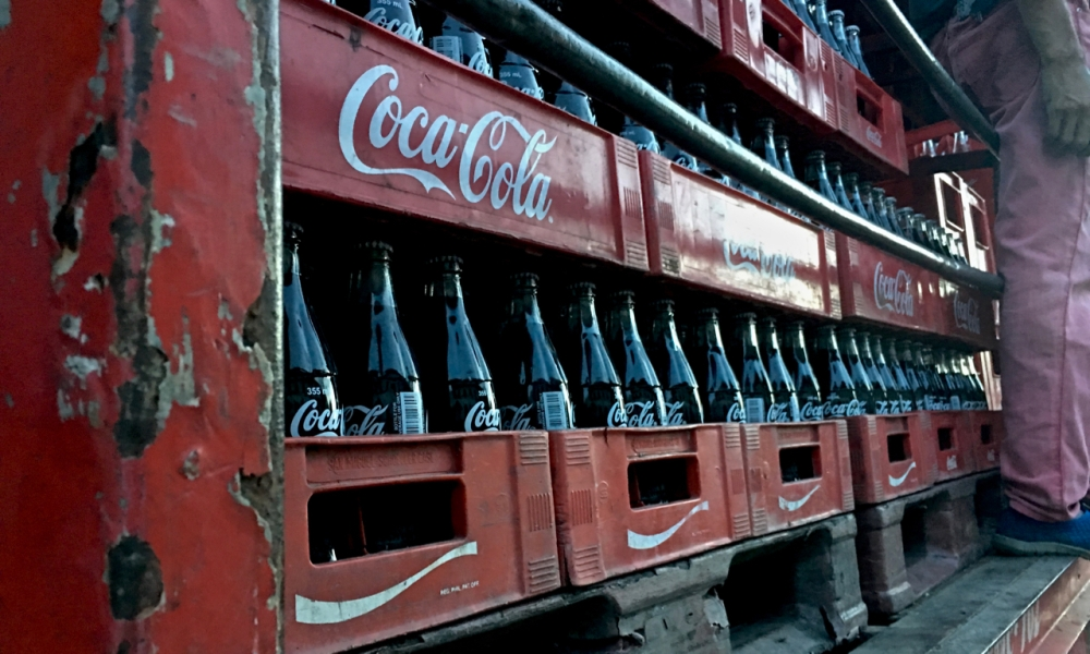 glass coke bottles stacked into a truck