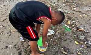 boy on the shoreline low tide